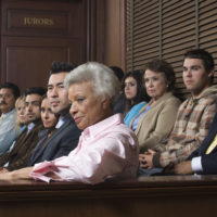 jurors sitting in jury box of a courtroom