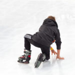 boy fell on ground while ice skating