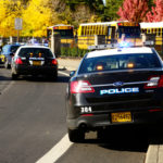 Police cars and school buses