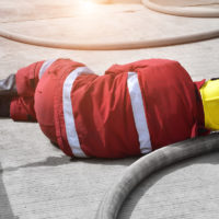 injured fireman on ground after work accident