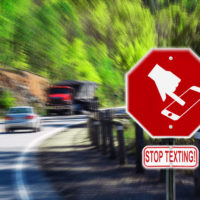 stop-texting-sign-with-a-car