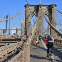 Bikers riding across brooklyn bridge