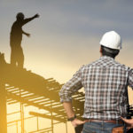 worker on top of a roof