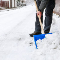 Guy shoveling snow