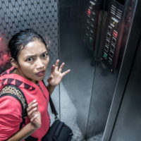 lady scared in an elevator