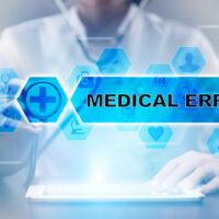 blue sign that reads medical error