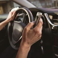 Driver texting while in car