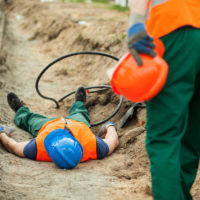 construction worker finds injured coworker by electrical cables