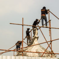 construction workers on a scaffold
