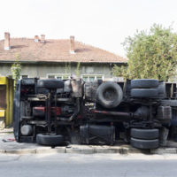 truck hits house