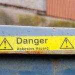 Danger yellow tape warning about asbestos