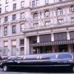 Black Limo pictured in front of building